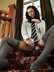 Brunette aristocratic girl in grey stockings