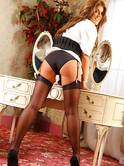 Kelly looks great in her college uniform with black sheer stockings