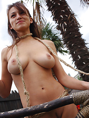 Sofi poses outdoors and flaunts her smoking hot body with her large puffy knockers under the afternoon sun.