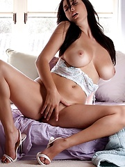 Jelena Jensen - shows off her spicy curves in white lingerie