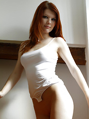 Armed with a naughty smile and seductive yet charming look, Mia Sollis is very tempting and exciting as she strips and flaunts her gorgeous body in fr