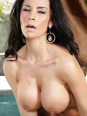 Gorgeous busty brunette, Laura Lee, unties her top exposing those bountiful tits, slides her bottoms off exposing that delicious pussy and models that
