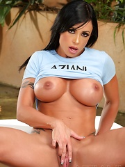 Ever popular and luscious busty brunette, Jewels Jade, strips out of her denim skirt giving you a peek at all she has.