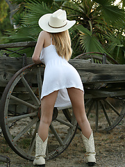 Cowgirl boots and a cowgirl hat Ashley loves to show off that wonderful body of hers