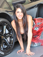 Lilly flashing by a car