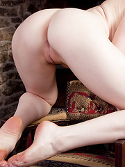 Tegan Jane fucks her pussy behind the fireplace