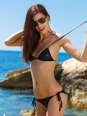 Candice Luka strips off her black bikini and basks naked under the sun