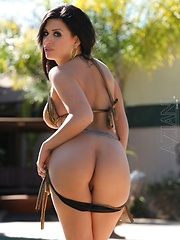 Brunette beauty Eva Angelina strips out of her sexy gold bikini by the pool.