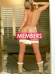 Ashley Brookes - White robe with white pantys in the doorway